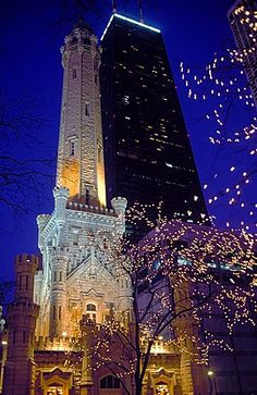 Water Tower and the John Hancock Center illuminated at night at Christmas time…