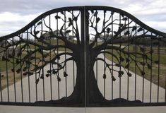 Nice tree-design metal gate, but you'd think they'd actually do some landscaping and plant some trees so this gate is more representative of the theme they began.
