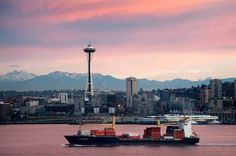 """""""Seattle"""" by Edmund Lowe, Seattle, Washington // Sunrise in Seattle, Washington. A cargo ship sails out of Elliott Bay and passes by the Space Needle. // Imagekind.com -- Buy stunning, museum-quality fine art prints, framed prints, and canvas prints directly from independent working artists and photographers."""