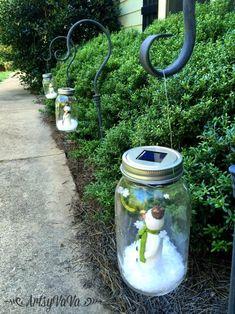 Drop a mini snowman into a mason jar to make this adorable light-up Christmas snow globe for your walkway