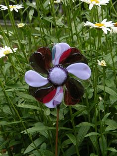 This flower always stays in bloom! One-of-a-kind decor for your garden. Completely handcrafted fused/stained glass flower garden stake in a unique,