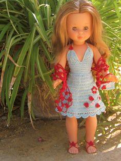 Nancy clásica con modelo azul y florecitas