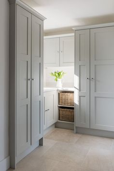 Grey cabinets in a beautiful laundry room with classic decor. 23 Tranquil Interiors with Light Grey and White and be inspired!
