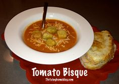 """Tomato Bisque Recipe: This soup was very good! I used three pounds of fresh tomatoes (cut them in half and put them in the blender w/ a little water) instead of canned. My guest said it was """"like Panera's, but better"""" I will be making it again."""