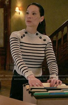 Joan's striped sweater with shoulder buttons on Elementary. Outfit Details: https://wornontv.net/56326/ #Elementary