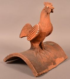 Redware Pottery Rooster Finial Roof Tile. Love these decorative finials. Rarely see them in N Ireland, but can still be seen in English villages RMcN