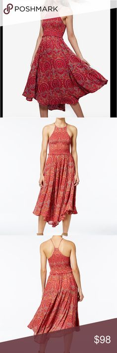 Free People Seasons In The Sun Printed Midi Dress Go for the ultimate bohemian vibe in this must have dress, a must have for effortless weekend style. Rayon. Hand wash. High neckline. T-back design. Pullover style. Sleeveless. Allover print. Unlined. Elastic at bodice. A symmetrical hem. Hits above ankle. Free People Dresses Midi