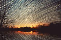 Star & Plane Trails Over Pond by Lauren Coakley