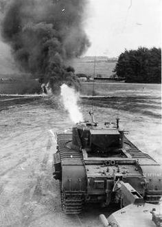British Churchill Crocodile Tank, towing the flame thrower's fuel in a trailer behind it.