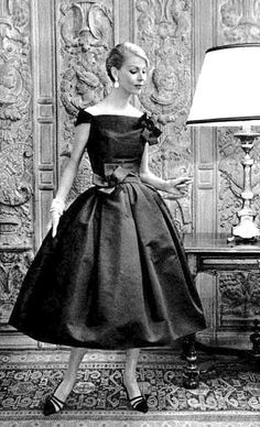 1957 Dior's short taffeta evening dress with small off-the-shoulder sleeves and a bouffant skirt from