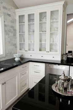 Nice use of marble subway tile with white cabinets (these are perfect in my book) and black counters
