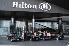Mustangs in Black 1966 and 1967 GT Convertible Mustang fleet at Hilton South Wharf in Melbourne for a wedding shoot, including our Shelby GT350.