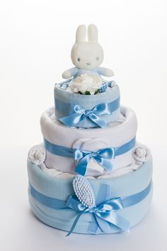 Featuring the popular Miffy the Rabbit, our gorgeous 3 tier nappy cake is a modern and unique gift for mum-to-be who is expecting a baby boy.  An ideal baby gift for a maternity or baby shower celebration, which includes baby essentials and a cleverly disguised keepsake capsule hidden inside, to help you treasure those very important memories.