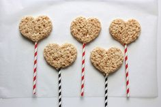 Heart-shaped treats for Valentine's Day -- stop there, or turn them into Rice Krispies Heart Pops via @Handmadebykelly. Click for the easy how-to.
