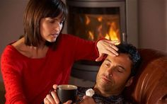 Woman tends to partner suffering from man flu