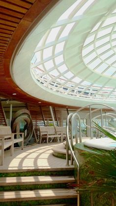 Oasis of the Seas | The solarium provides a quaint and greenery-infused alternative to sunbathing on the many outdoor decks on Royal Caribbean's Oasis Class.