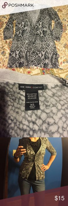 New York & Co. snake print cardigan Snake print v-neck cardigan. 5 buttons and 3/4 length sleeves. New York & Company Tops
