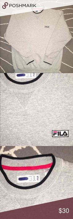Grey FILA Sweatshirt Bought it and never wore it.  Has never even been washed. Grey and lined with black with the iconic FILA logo on the chest No stains rips or holes Men's M  Originally paid $60 from Urban Outfitters Fila Shirts Sweatshirts & Hoodies