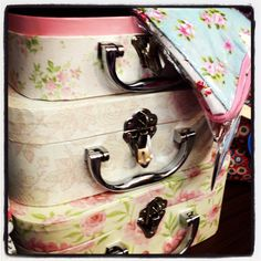Vintage flower patterned mini suitcases, perfect for storing accessories or just making things look pretty!