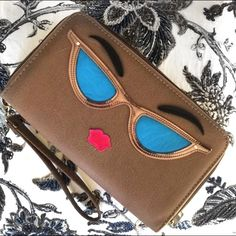 NOVELTY ZIP AROUND CLUTCH WITH WRIST STRAP So cute and perfect to hold your phone and essentials!! New with tags 8 credit card slots, zippered coin compartment, 2 currency slots, cell phone compartment.  It is a taupe color. Bags Clutches & Wristlets