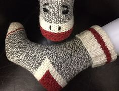 """These adorable socks are cast on at the cuff and include a 'clean' stripe plus a turning round in the ribbing. For the traditional sock monkey look, 3 colours of Briggs & Little 'Tuffy"""" are required, but there will be lots of red mix and ecru left over! (For the main colour, Granite, I used about 65% of the skein for my ladies' small socks.) free pattern"""