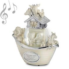"""♫ Plays """"Talk to the Animals"""" A delightful snow globe that tastefully mixes white bisque with silver touches for a gift her baby will want to keep for a lifetime. Just engrave it with his or her name and birth date! Rotates and plays """"Talk to the Animals"""" as glitter falls inside the globe where elephants snuggle. https://www.thingsremembered.com/noahs-ark-musical-snow-globe/product/669111?fcref=pinterest&beta=1"""