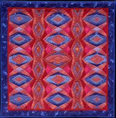 """Jeweled Ornament """"The inspiration for this quilt is the striking color combination found in my favorite fabric of all time... a Paisley designed by Charles Demery for Souleiado in France.""""  -Pamela Zave"""