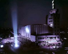 "This photo is so perfectly lit and composed that it almost looks like it's from a movie, and not about one. What we're seeing here is the world premiere of ""Trapeze"" at the Fox Wilshire Theatre, 8440 Wilshire Blvd. Beverly Hills on May 29, 1956. The super bright searchlight trained directly on the entrance must have been blinding, and that shaft of light reaching straight up into the night sky would have been visible for miles around."
