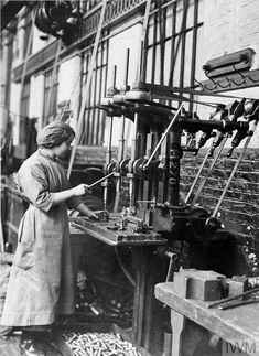 WWI, 15 May 1917; Female employee of the Lancashire and Yorkshire Railway operating a three spindle drilling machine. ©IWM Q 109876