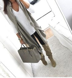 v neck baggy sweater, scarf, skinny pants...different boots