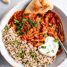 Slow Cooker Chicken Tikka Masala is a lightened up comforting Indian dish made with tomato sauce, chicken breast, coconut milk and flavorful, bold spices. Slow Cooker Chicken Healthy, Slow Cooker Recipes, Crockpot Recipes, Chicken Recipes, Chicken Cooker, Rice Recipes, Meat Recipes, Chili Recipes, Recipies