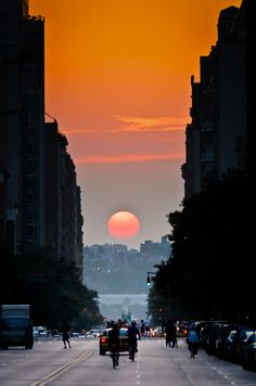 Manhattanhenge, semiannual occurrence where the sun aligns perfectly with east west streets of New York