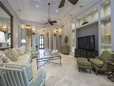1568 Marsh Wren Lane, Naples, FL | Comfortable traditional family room in Estuary at Grey Oaks