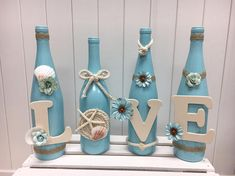 Painted wine bottles decorated in a Beach Love theme ready to decorate your home, wedding or special party