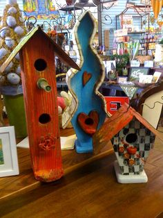 These whimsical birdhouses are awesome.  Made from recycled wood and various found objects, each one has it's own unique personality.