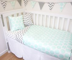 ♡ All fabrics are a 100% cotton ♡ Batting is synthetic – making this blanket warm and soft! ♡ Easy care and machine washable - gentle cycle ♡ Every item is handmade on the Gold Coast, Australia. ♡ Made by a professional seamstress, with an eye for detail! Cot quilt 100cm x 130cm: White/Grey chevron AND Mint dots Fitted sheet (to fit up to 75cm x 135cm x 12cm): ARROWS - White with blue green arrows Fitted sheet (to fit up to 75cm x 135cm x 12cm): DOTS: White with grey dots Cushion 1: W...