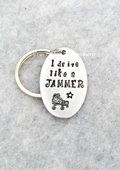 I drive like a jammer key chain - also available as a zipper pull for your gear bag - can be totally customized and makes a great roller derby gift! Awesome end of season gift or present for your derby wife Erin Makes Impressions on etsy. Lots more roller derby items: http://etsy.me/21qziz7