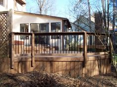 A deck with composite solid board skirting and composite rail with metal pickets
