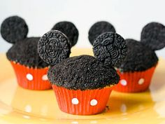 Bake cupcakes in red muffin liners, frost and dip in chocolate cookie crumbs. Then use toothpicks to attach Oreo cookies for the ears.