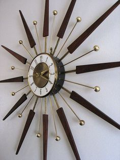 Starburst wall clock....I've been looking ALL over Asheboro for one of these!