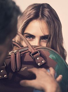 Cara Delevingne shows off Burberry's AW14 accessory range