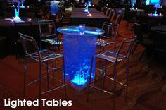 Lighted Tables - Create unique seating arrangements for you and your guests with our lighted tables. They are sure to attract attention and give the room and icy blue feeling.