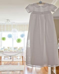 The white christening gown, the white bonnet and christening blanket are so evocative of this traditional rite of passage for baby