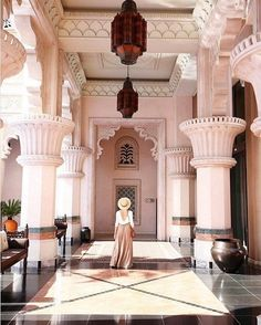 While we can't all visit to Dubai to stay in the inimitable Al Qasr Hotel, we can glean endless amounts of inspiration from its sky-high ceilings, column-lined halls, and impeccably pink exterior.