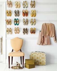 Pretty shoes hanging on strips of crown molding.  Functional decorating is my favorite kind.