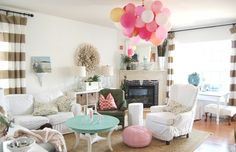 Major wow factor and inexpensive party decor - tie a bunch of balloons together and drape on your chandelier