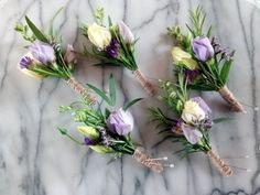 Eustoma and Rosemary buttonholes bound with twine by The Yorkshire Dales Flower Company www.yorkshiredalesflowers.co.uk
