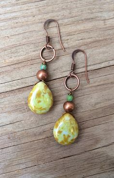 Made with green Picasso glass teardrops, copper and a bit of turquoise, these earrings will add a little splash of color! Approx 1.5 in length.