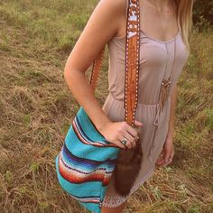 Serape handbag with coyote tail and tooled leather belt strap