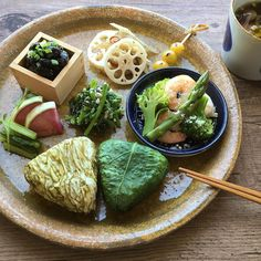 Unpolished rice balls(pickled turnip green,kelp),steamed shrimp and vegetables salad,boiled garland chrysanthemum and wakame seaweed dressed with walnut,Kinpira-style sauteed lotus root and burdock,fermented black soybean,miso soup with sweet potato and shimeji mashroom,and so on.